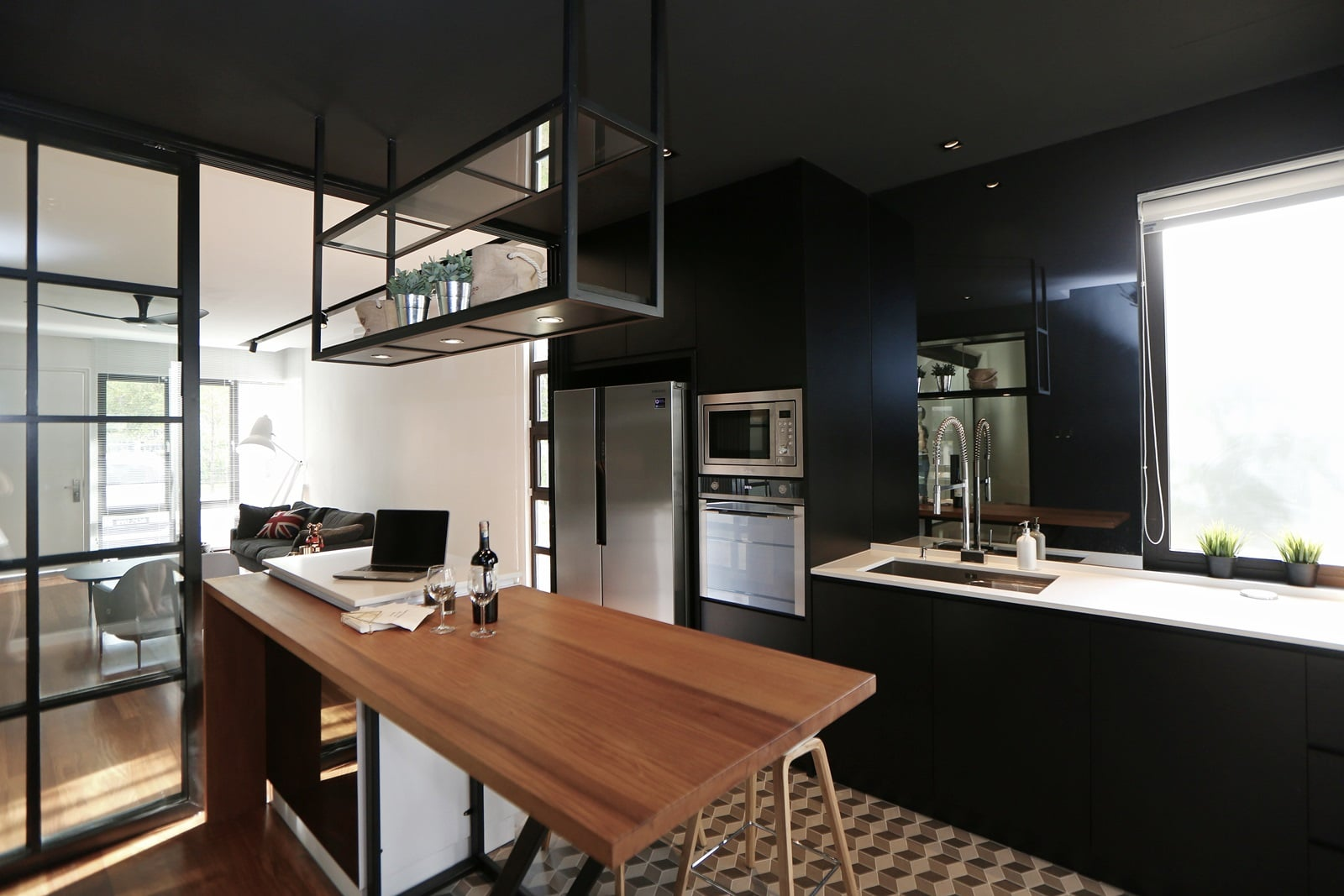 Darker finishing for built-in kitchen cabinets contrast beautifully against the white and wood grain finishing of the island counter.
