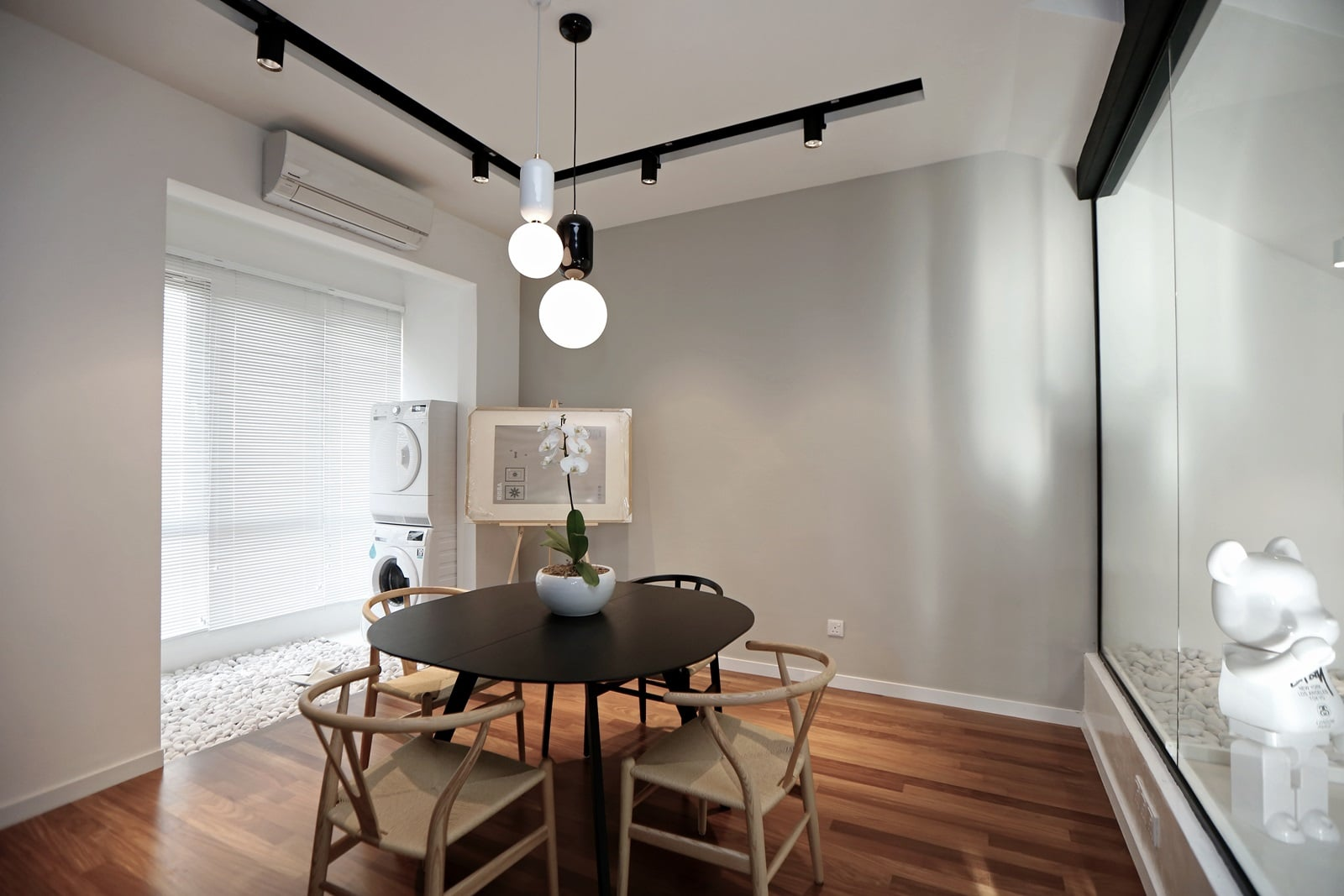 Townhouse dining area designed to look brighter and subtly hiding its darker design elements.