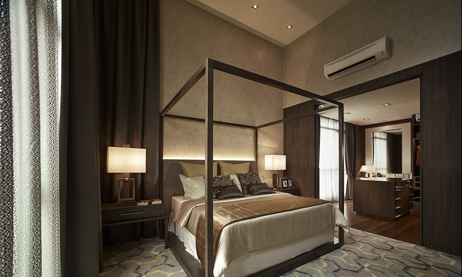 Soft lighting, a four poster bed combined with an earthy colour scheme define the look of the master bedroom.
