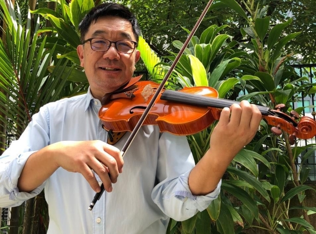 """""""Through classical music, you'll see the building of the musicality within yourself"""": An interview with NUS Symphony Orchestra conductor Mr. Lim Soon Lee"""