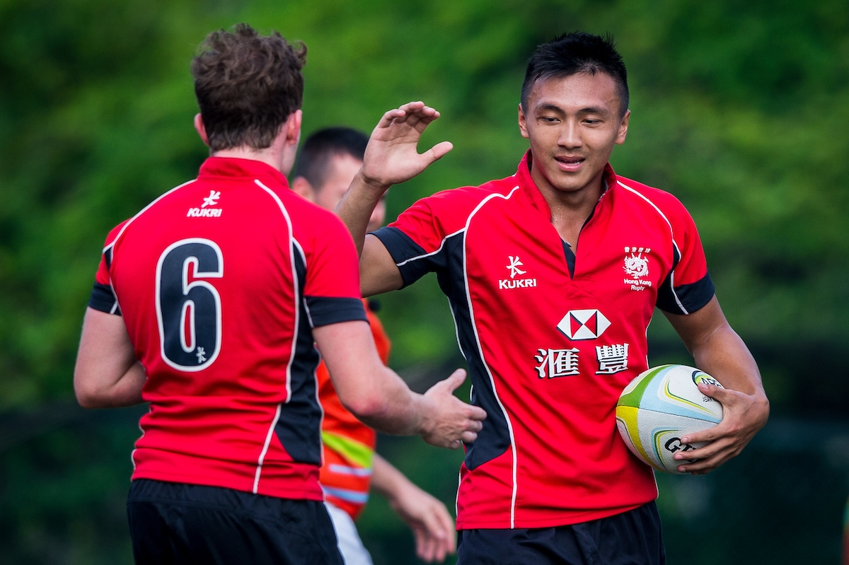 Erick Kwok (right) high five with his U20 teammates