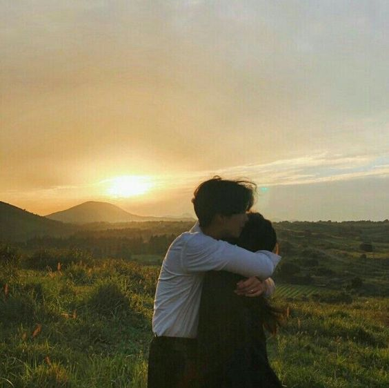 couple hugging during sunset