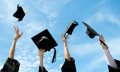 Graduates throwing their caps, hr