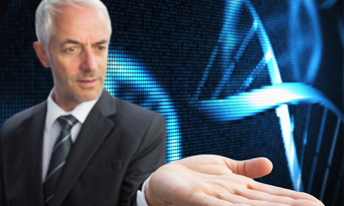 Businessman holding up a stand of DNA molecule to show how your genes might impact your leadership style