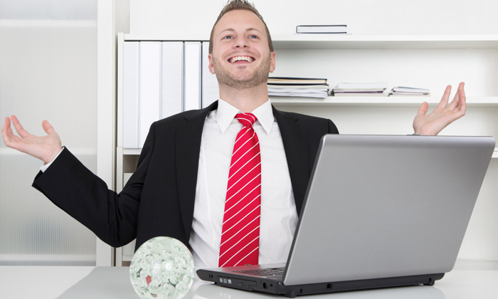 Businessman holding hands up in the air to show he's having a perfect job