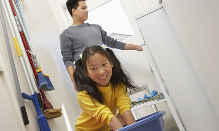 Father and daughter doing chores