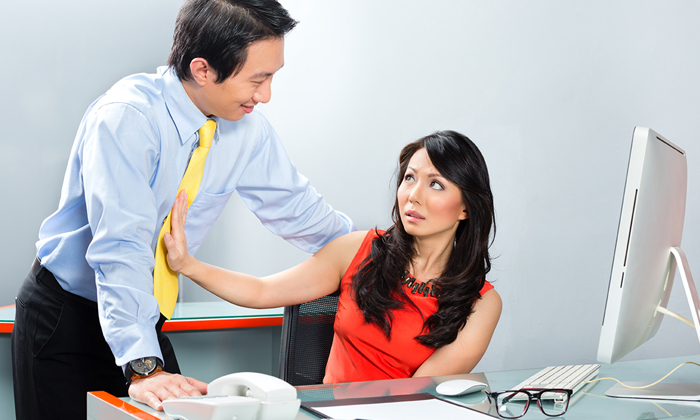 Sexual harassment in the office woman pushes man away