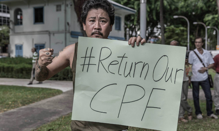 #ReturnourCPF protest. Photo by Lawrence Chong
