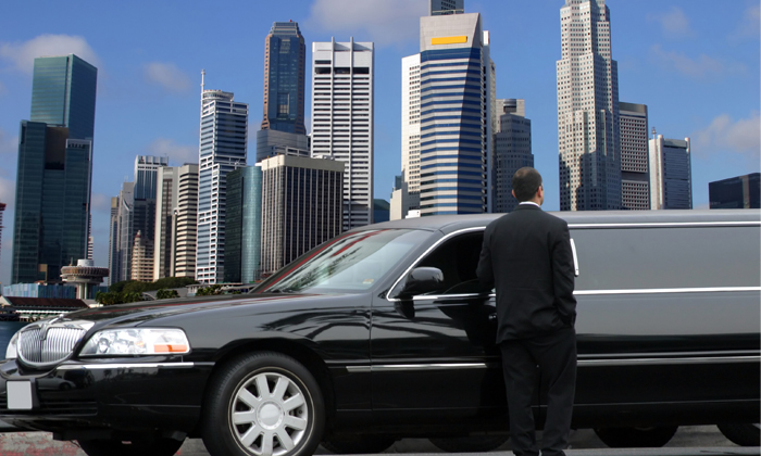 Singapore building with car to show Singapore's richest