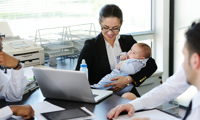 woman feeding baby at work, flexible workplaces in Singapore