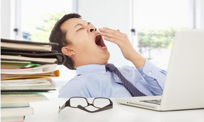 Sleepy Asian businessman