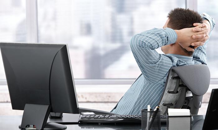 Man working by office window