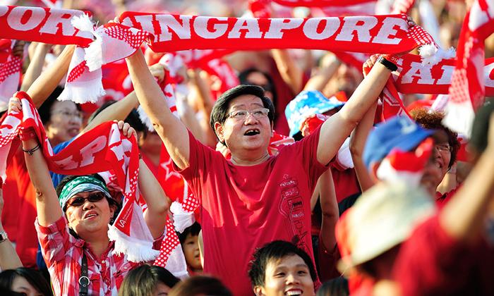 Man celebrating Singapore's National Day