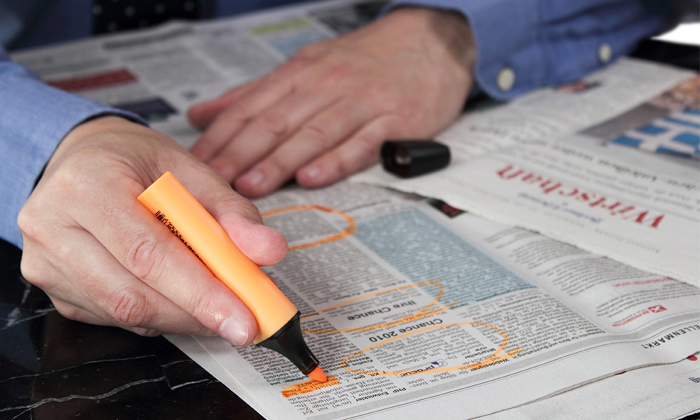 Man searching for jobs in papers