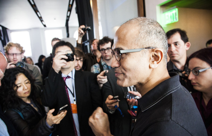 Satya Nadella Microsoft surrounded by reporters