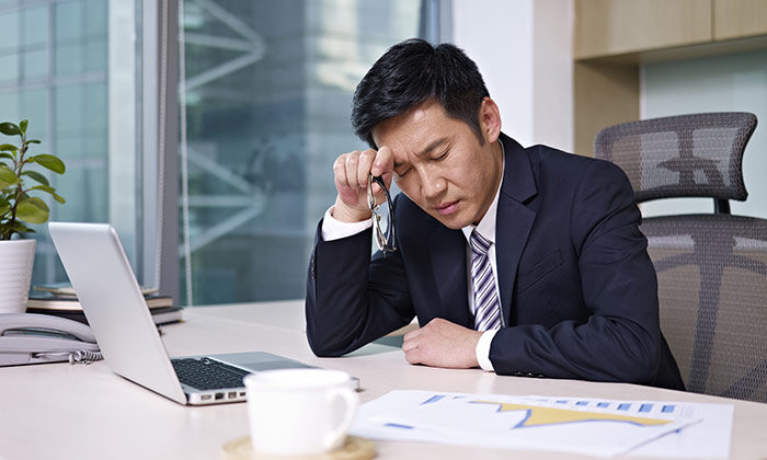 Stressed employee Asian
