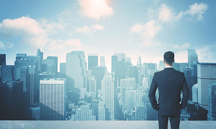 businessman looking at future city