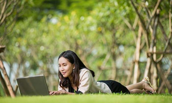 Business woman in the park with laptop, hr