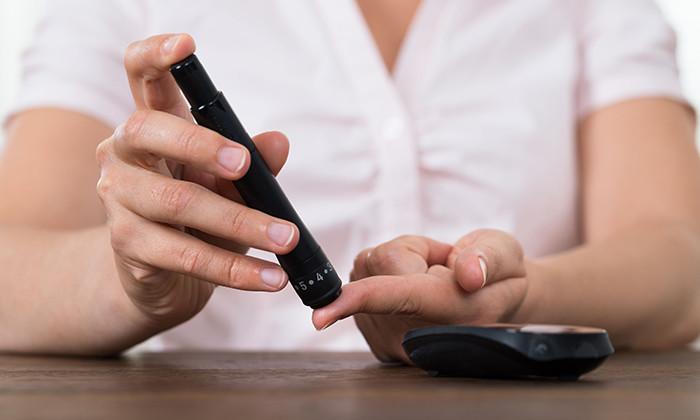 Woman testing blood sugar levels, hr