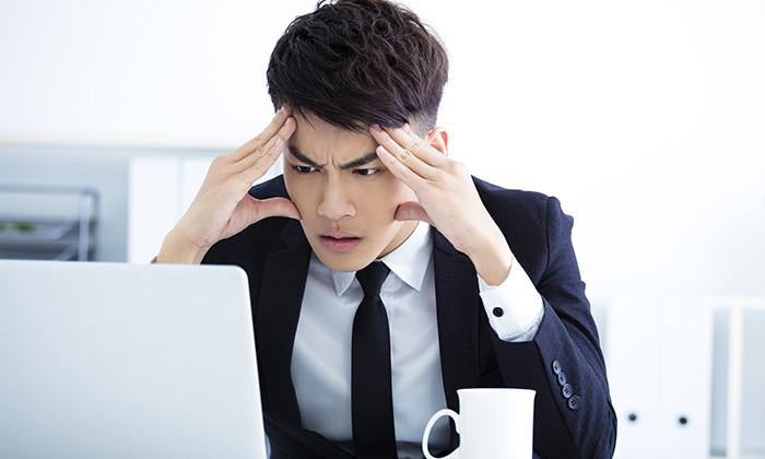 sad worker at his desk