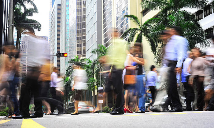 PMETs walking through Singapore's bustling CBD