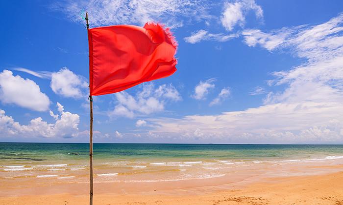 Red flag on a beach, hr