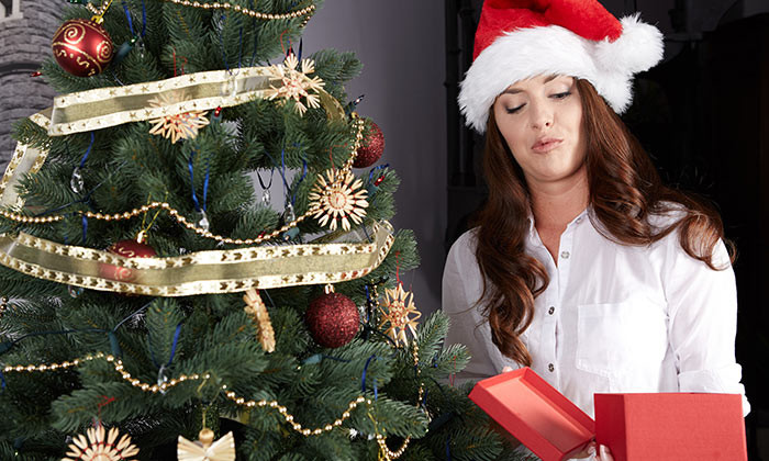 woman unhappy with christmas gift