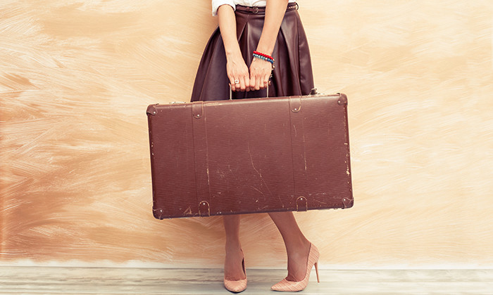 Employee mobility - woman holding a suitcase