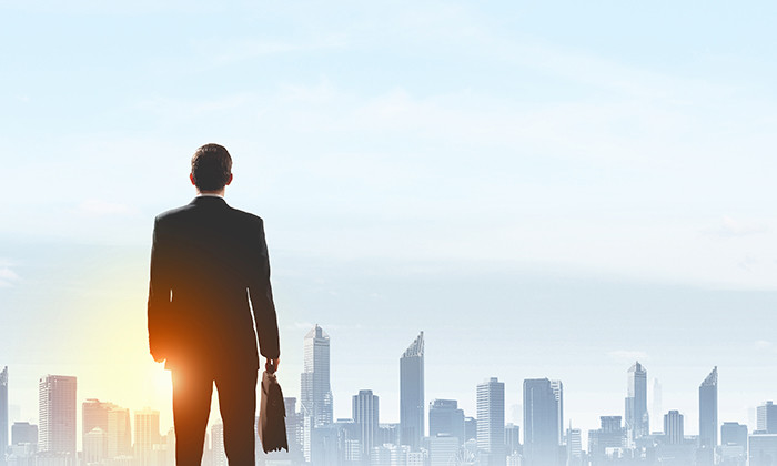 Businessman looking out over a city, hr