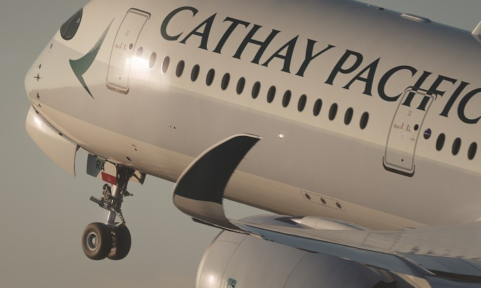 Cathay Pacific aircraft in flight, hr