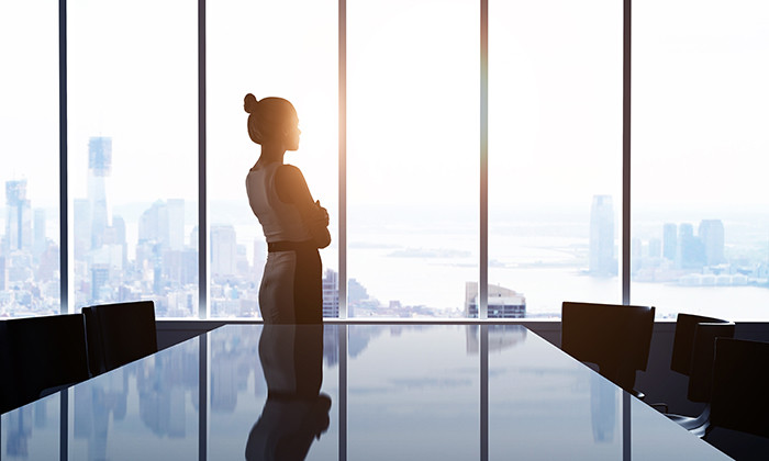 Business woman looking out of corporate office, hr