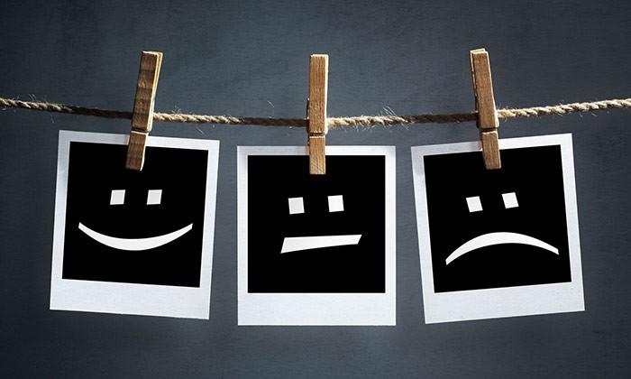 happy to sad faces - 123RF
