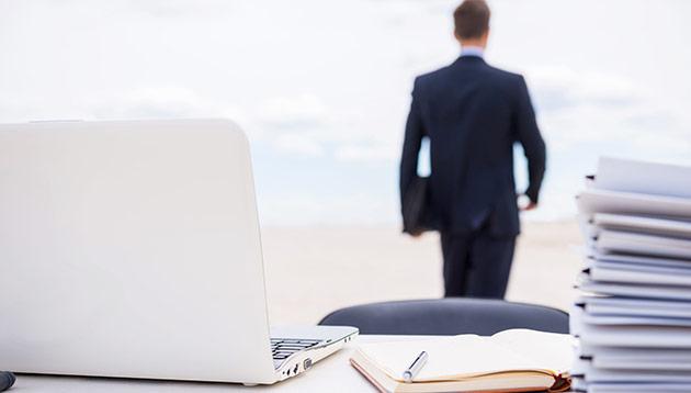 businessman walking away from desk - 123RF