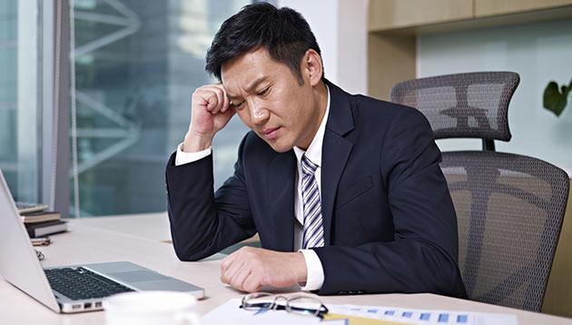unhappy businessman - 123RF