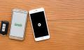 Grab and Uber app - 123RF
