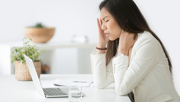 Stressed-businesswoman-iStock