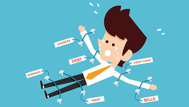 businessman-tied-down-with-debt-123RF