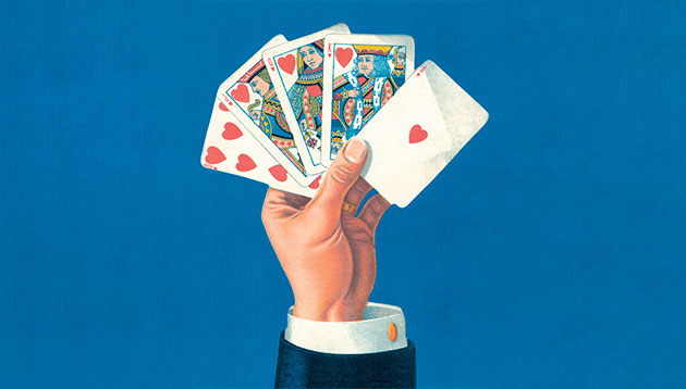 person-holding-playing-cards