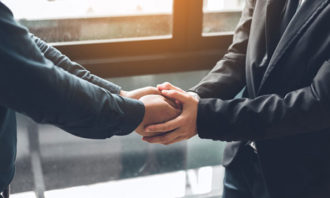 two-people-shaking-hands-iStock
