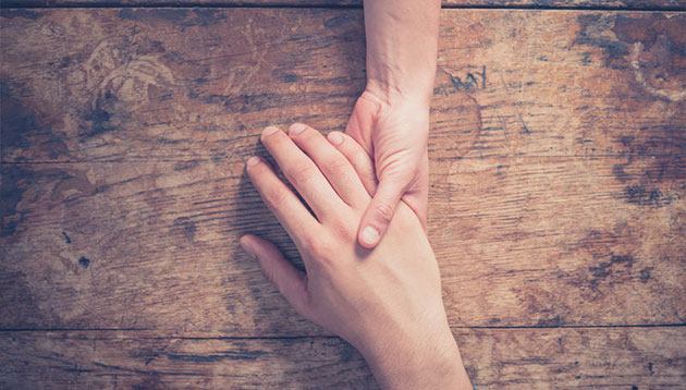 Priya-Oct-2019-cancer-treatment-hands-close-up-123RF