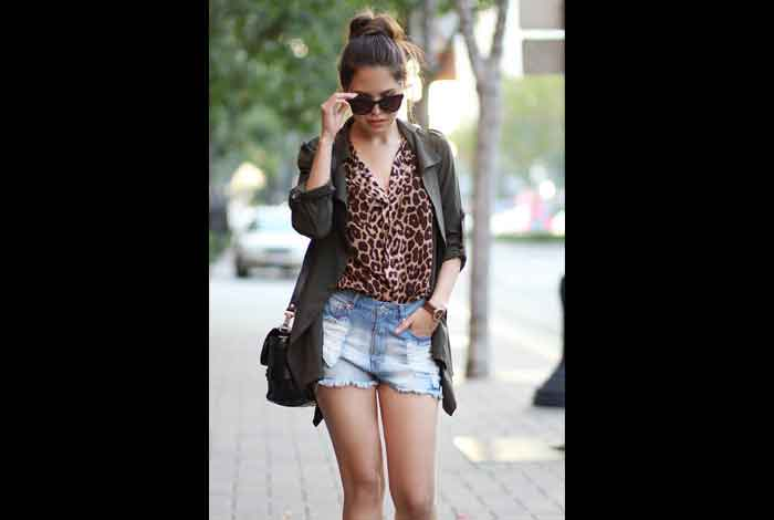 Team up a Leopard-Print Blouse with Denim Cutoffs