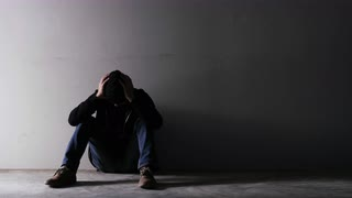 Asian troubled man wearing a hood in an empty room 4jm3hiay  s0000