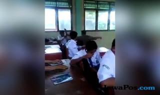 pemukulan murid