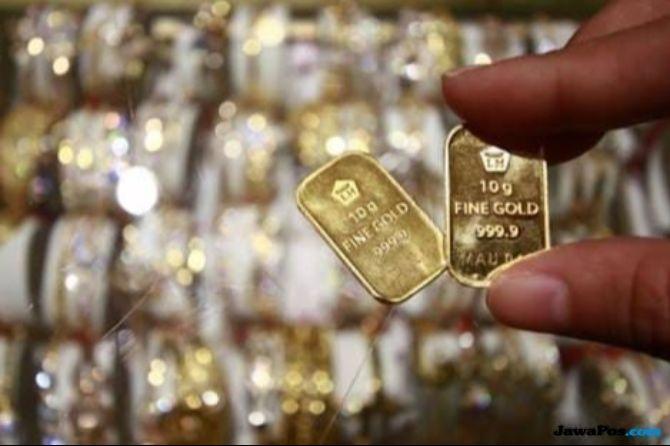 Kecemasan Perang Dagang Bikin Harga Emas Dunia Meredup