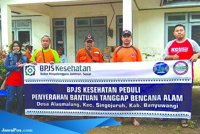 BERBAGI RASA: BPJS Kesehatan peduli tanggap bencana juga menyalurkan bantuan kepada korban bencana alam di Desa Alasmalang.