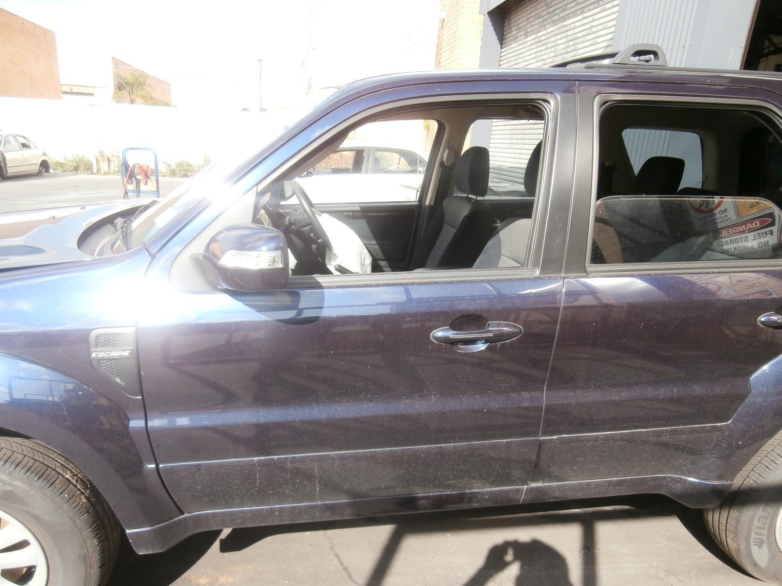 View Auto part Left Front Window Reg/Motor Ford Escape 2009