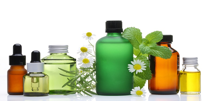 Essential oil  glass bottles with rosemary, mint and chamomile f