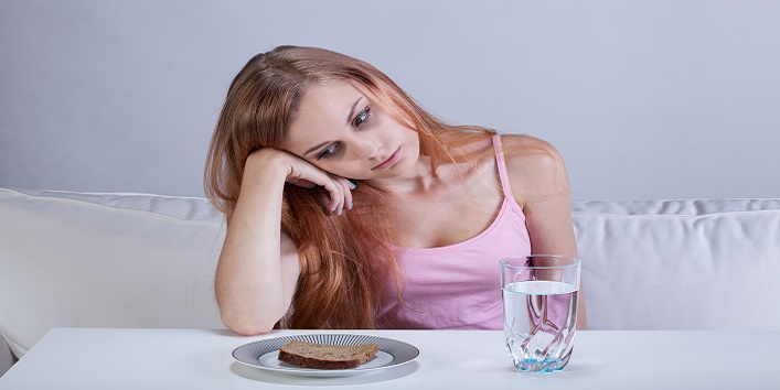 Depressed girl with eating disorder