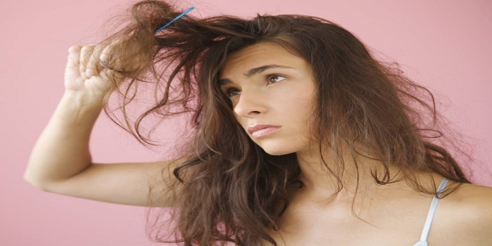 Woman combing knotted hair