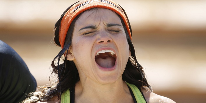 A woman screams after plunging into icy water during the Tough Mudder 10-12 mile obstacle challenge in San Bernardino, California March 28, 2015. REUTERS/Lucy Nicholson - RTR4VB6I